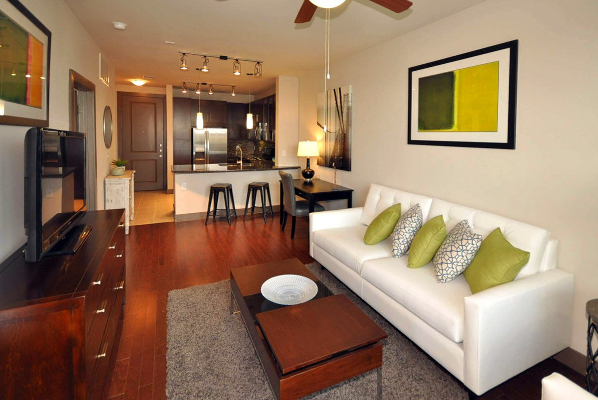 Living room setup with rental furniture from Brook Furniture Rental at 577 Hermann Park Apartments